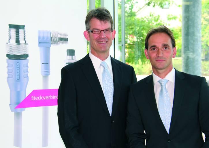 Dipl.-Ing. Dietrich Turck (links) und Dipl.-Wirt-Ing. Marco Heck (rechts) führen die ESCHA Bauelemente GmbH seit 14. August 2013 gemeinsam.