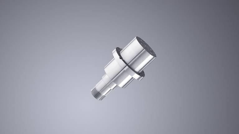 Aus dem in einer Werkstückaufnahme befestigten, konventionell gefertigten Unterteil (Preform) wächst mittels Pulverauftrag Schicht für Schicht das additiv optimierte obere Bauteil.