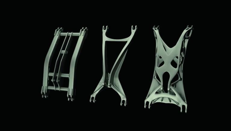 Alte geschweißte Fahrwerksschwinge (links) und zwei neue Designs für den Guss im Vergleich (mitte und rechts): Die rechte Variante ist mithilfe des 3D-Drucks 45 kg leichter als das Original und zudem um 272 % langlebiger.