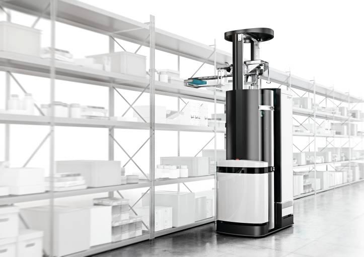 Der Logistik-Roboter TORU kombiniert autonomes Fahren mit Handlings-Robotik. Per Unterdruck werden die Waren aus dem Regal genommen. Eine Metallzunge schließt vor dem Ansaugen die Lücke zwischen Regalboden und dem Logistikroboter. Sowohl das Ausfahren der Zunge als auch das Bewegen des Greifarms übernehmen bürstenlose DC-Servomotoren von Faulhaber. (Bild: Magazino)